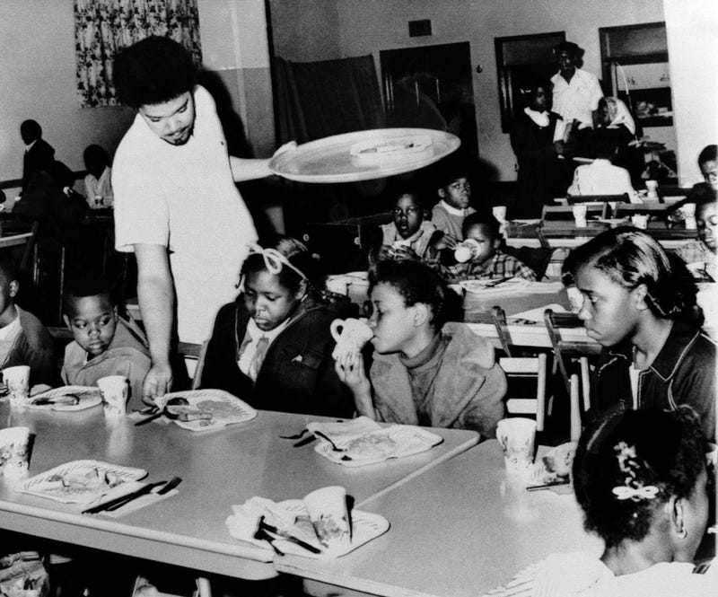 Bill Whitfield, a member of the Black Panther chapter in Kansas City, serves free breakfast to children before they go to school in this April 16, 1969, file photo. (William P. Straeter, File/AP Images)