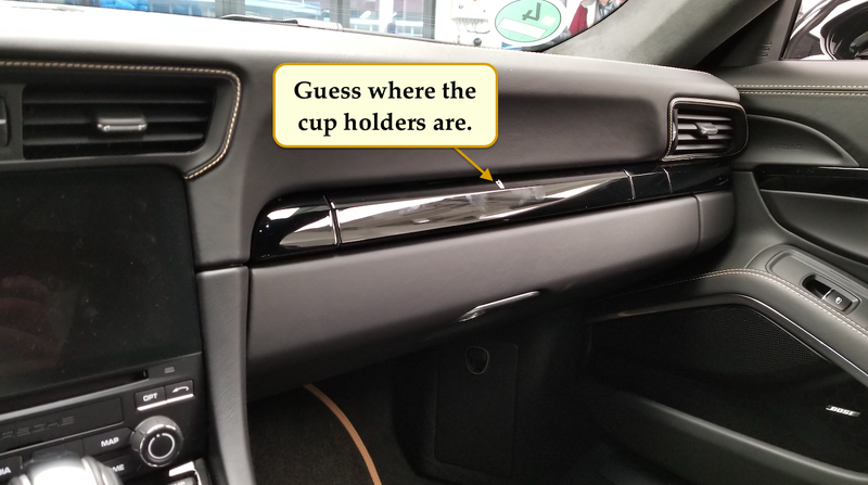 The Needlessly Complicated Cupholders in the Porsche 911 Are Awesome