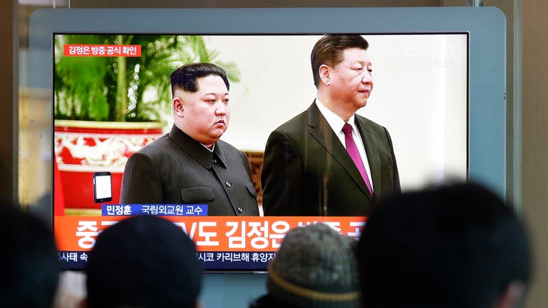 "South Koreans in Seoul watching ""file footage of North Korean leader Kim Jong Un and Chinese President Xi Jinping"" on Jan. 8, 2019."