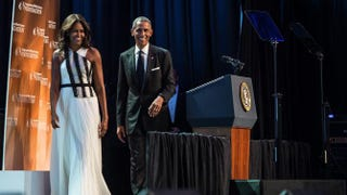 President Barack Obama arrives onstage with first lady Michelle Obama before speaking at the Congressional Black Caucus Foundation's 44th Annual Legislative Conference Phoenix Awards Dinner in Washington, D.C., Sept. 27, 2014.Nicholas Kamm/Getty Images