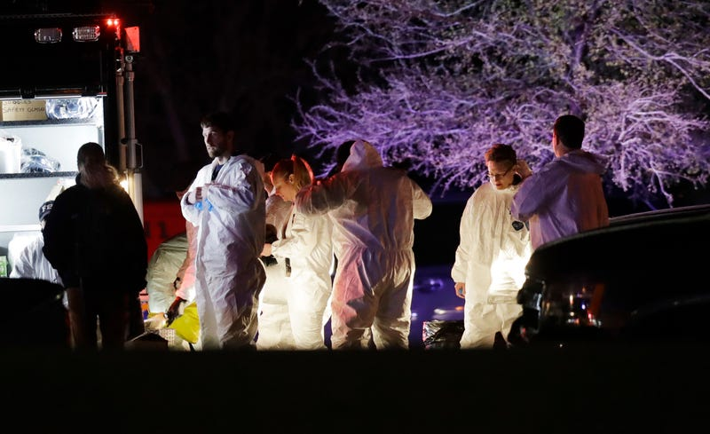 Members of law enforcement gather near the area in Round Rock, Texas, where a suspect in a series of bombing attacks in the city of Austin, Texas, blew himself up as authorities closed in, March 21, 2018.