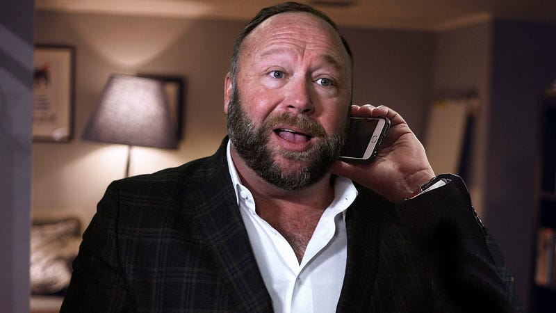 Illustration for article titled Alex Jones Struggling To Convince Skeptical Police After Witnessing Actual Murder In Neighbor's Backyard