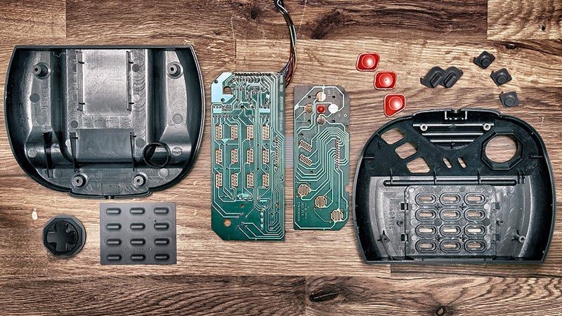 Illustration for article titled Deconstructed Gaming Controllers Reveal Gorgeous Old School Guts