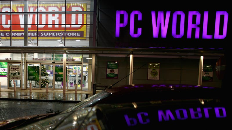 A customer walks out of the PC World store at Braehead Retail Park on November 27, 2008 in Glasgow, Scotland.