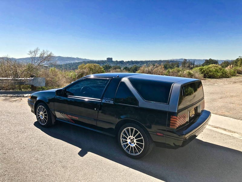 Illustration for article titled For $5,000, Could This Two-Top Two-Back 1987 Nissan Pulsar NX SE Be Too Much?
