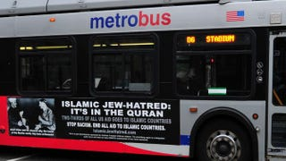 A Metro bus, featuring a controversial American Freedom Defense Initiative ad, on a street in Washington, D.C., May 21, 2014KAREN BLEIER/Getty Images