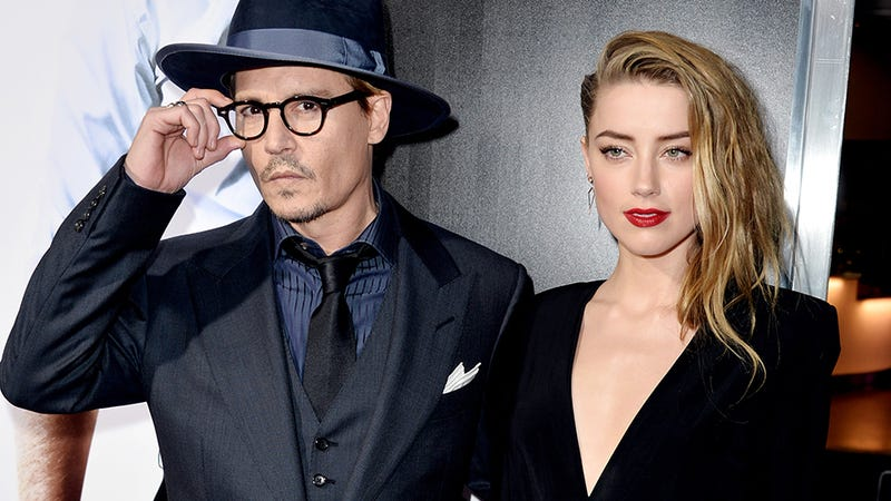 Illustration for article titled Unsolicited Uterus Update: Johnny Depp's Fiancée Amber Heard Pregnant