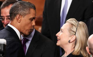 President Barack Obama greets then-Secretary of State Hillary Rodham Clinton at his State of the Union address on Jan. 24, 2012, in Washington, D.C.Win McNamee/Getty Images