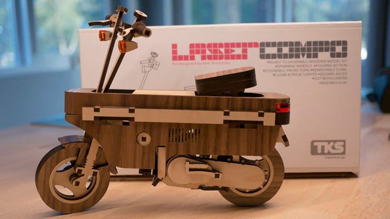Illustration for article titled Buy The Hell Out Of This Awesome Little Laser-Cut Wooden Honda Motocompo Model