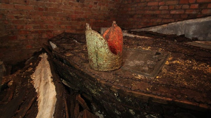 An Archbishop's gold Mitre rests atop a lead coffin. (Image: Garden Museum)