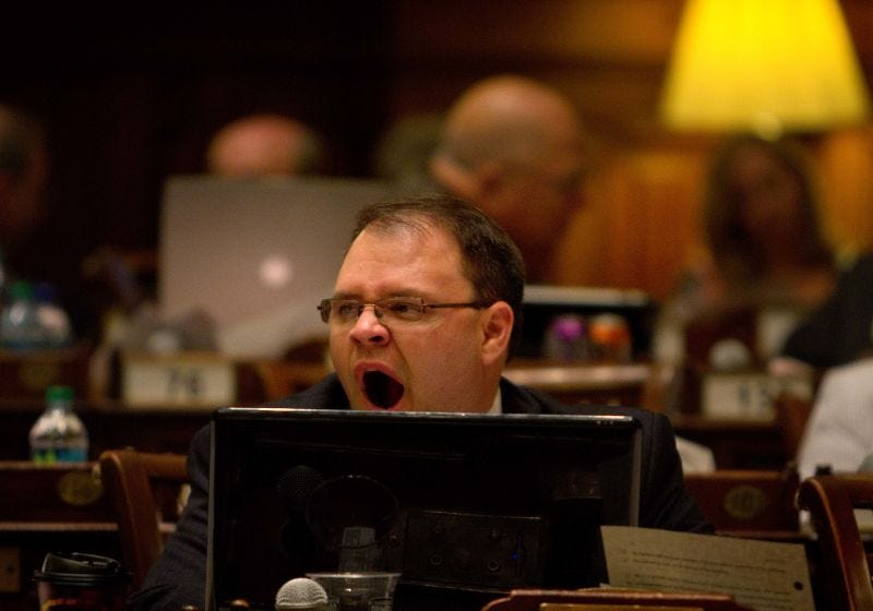 Republican Georgia State Rep. Jason Spencer yawns as proceedings continue into the night in the House chamber on the final day of the legislative session Thursday, April 14, 2011 in Atlanta.