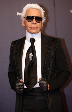 """Illustration for article titled Lagerfeld Gets Modest, Valentino Gets Fined, Von Furstenberg Gets """"Space"""""""