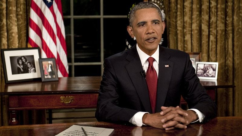 Illustration for article titled Obama Practices Defiant Speech To Aliens Late At Night Behind Oval Office Desk