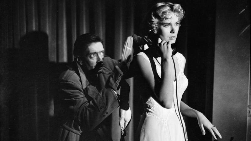 Anthony Dawson sneaks up behind a landline-bound Grace Kelly in 1954's Dial M For Murder, directed by Alfred Hitchcock. (Photo: John Kobal Foundation/Getty Images)