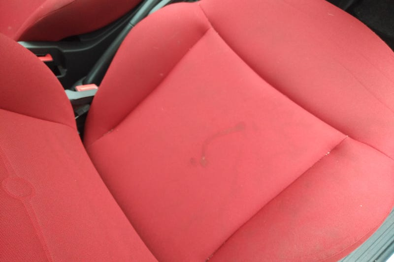 Driver's seat with chocolate stains and general marking from wear and tear