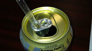 Illustration for article titled Thread a Straw Through the Tab on a Soda Can to Keep It from Rising