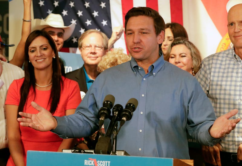 In this Thursday, Sept. 6, 2018, file photo, Florida Republican gubernatorial candidate Ron DeSantis speaks to supporters as his lieutenant governor candidate, state Rep. Jeanette Nunez, left, listens during a rally in Orlando, Fla. DeSantis resigned from Congress on Monday, Sept. 10, to focus on his bid to become Florida's next governor.