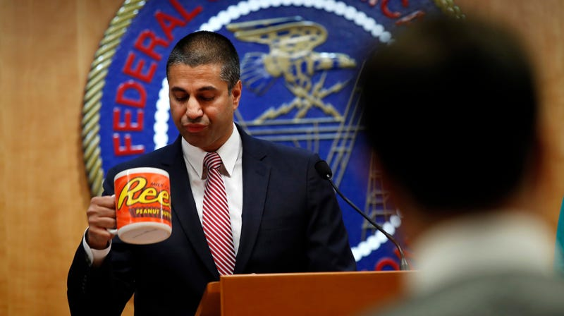 After a meeting voting to end net neutrality, Federal Communications Commission (FCC) Chairman Ajit Pai, takes a sip from his comically over-sized mug while answering questions from the media.