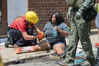 A woman received first aid after a car  ran into a crowd of protesters in Charlottesville, Va., on Aug. 12, 2017. (Paul J. Richards/AFP/Getty Images)