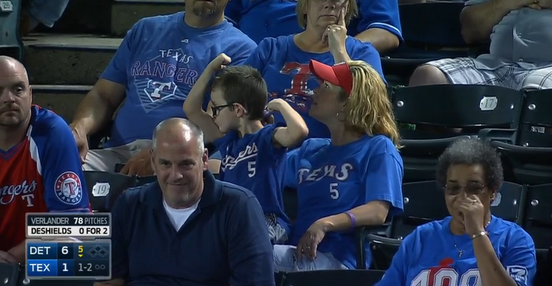 Illustration for article titled Kid At Rangers Game Won't Stop Flexing And Kissing His Biceps