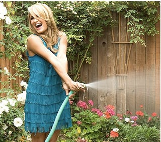 Illustration for article titled Jenn Brown Is Ready For Her Close-Up While Spraying A Garden Hose