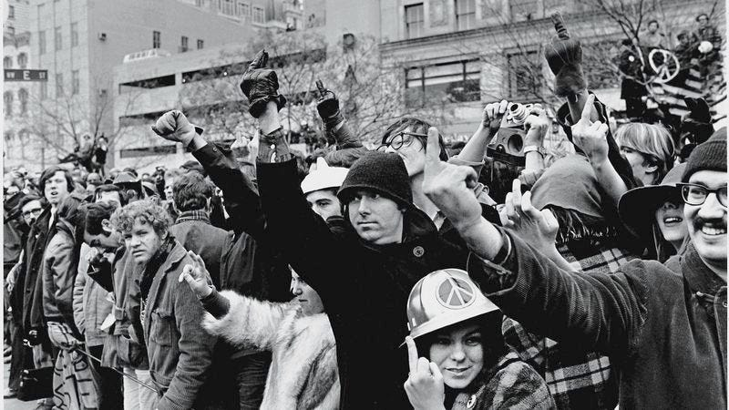 """A group of young Americans protest and show displeasure by giving """"the finger"""" during the inauguration of President Richard Nixon, Washington, DC, January 18-21, 1968. (Photo: David Fenton/Getty Images)"""
