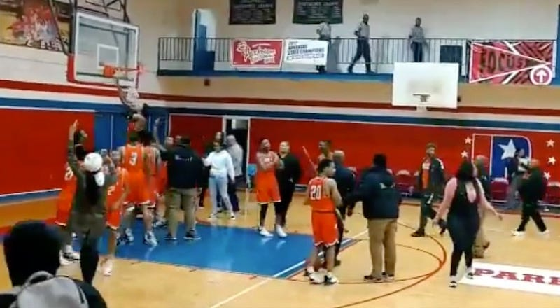 High School Basketball Team Enters Taunting Hall Of Fame After Cutting Down Net On Rival's Home Court