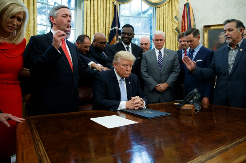 05eef6a6b Faith leaders praying with President Donald Trump in the White House on  Sept. 1,