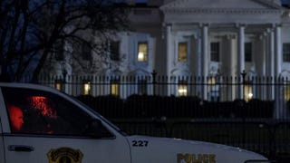 A member of the Secret Service's Uniformed Division sits in his car on Pennsylvania Avenue outside the White House Jan. 26, 2015, in Washington, D.C.BRENDAN SMIALOWSKI/Getty Images