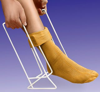 Illustration for article titled A Tool to Help Pull Socks Up