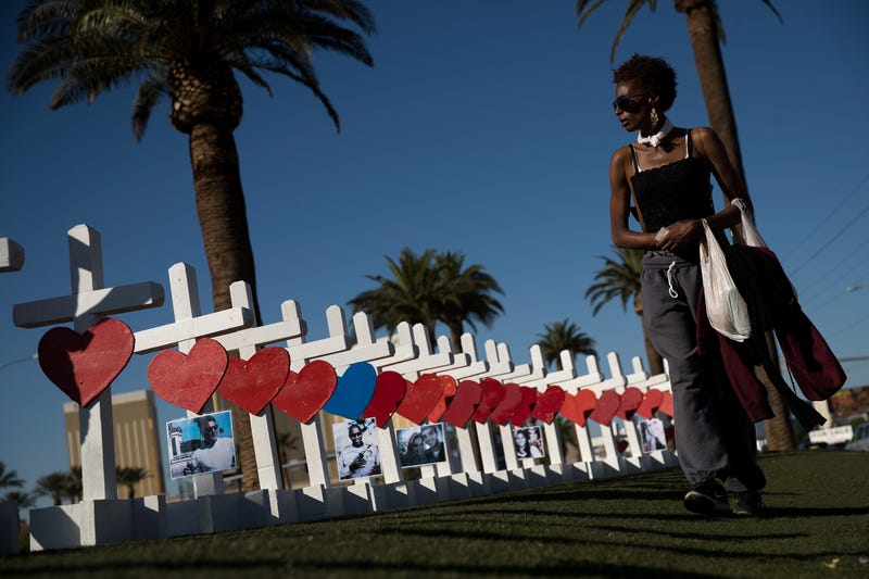 A woman walks past some of the 58 white crosses for the victims of the mass shooting Oct. 1, on the south end of the Las Vegas Strip, on Oct. 5, 2017. (Drew Angerer/Getty Images)