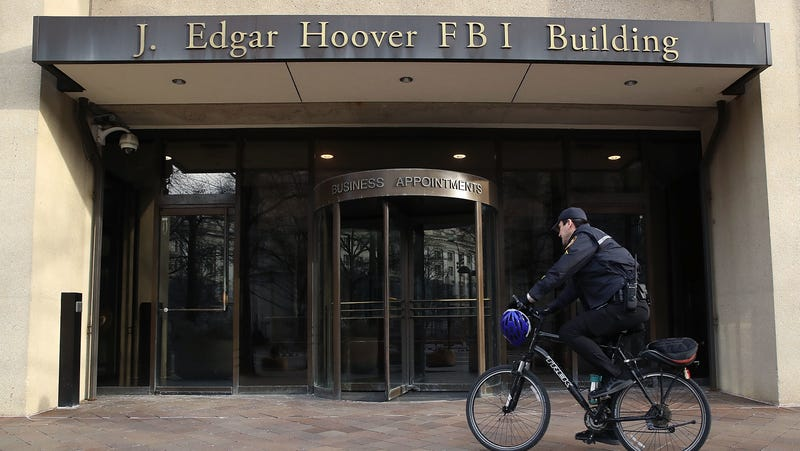 A law enforcement officer arrives at the J. Edgar Hoover FBI Building on January 28, 2019 in Washington, DC.