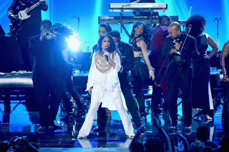 Sheila E. (center) performs onstage during the 2016 BET Awards at the Microsoft Theater June 26, 2016, in Los Angeles.  Kevin Winter/BET/Getty Images for BET