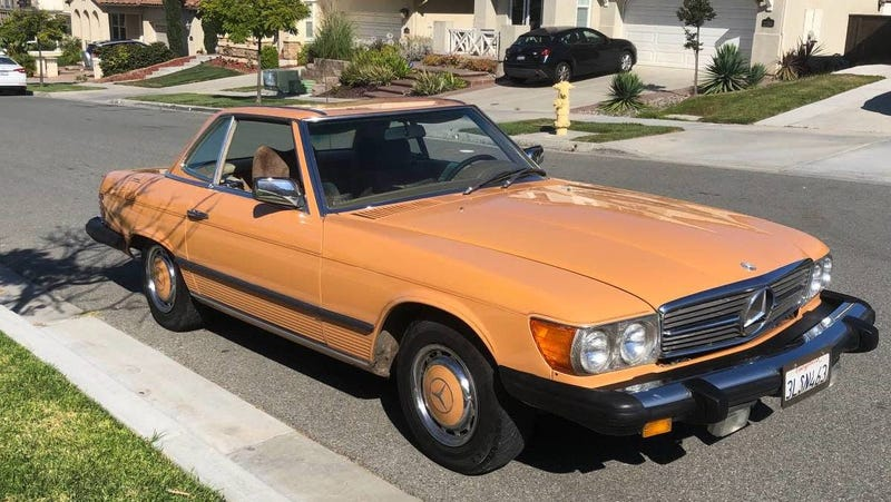 Illustration for article titled At $7,999, Is This Cayenne Orange 1976 Mercedes 450SL Ripe For The Picking?