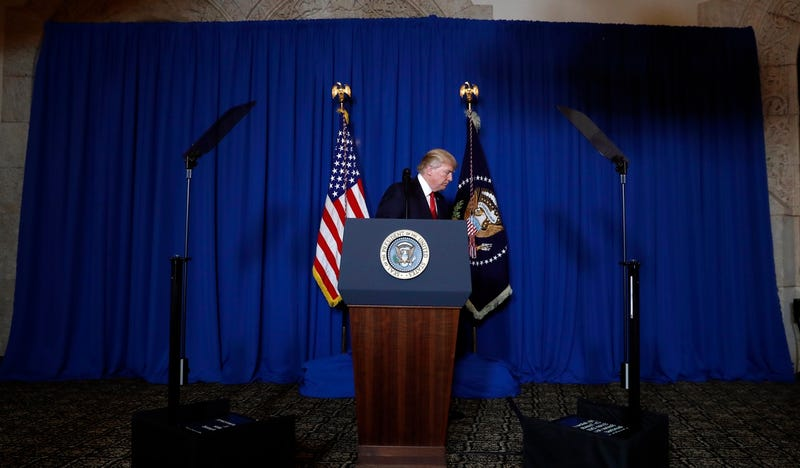 President Donald Trump leaves the podium after speaking at Mar-a-Lago on Thursday, April 6, 2017 (AP Photo/Alex Brandon)