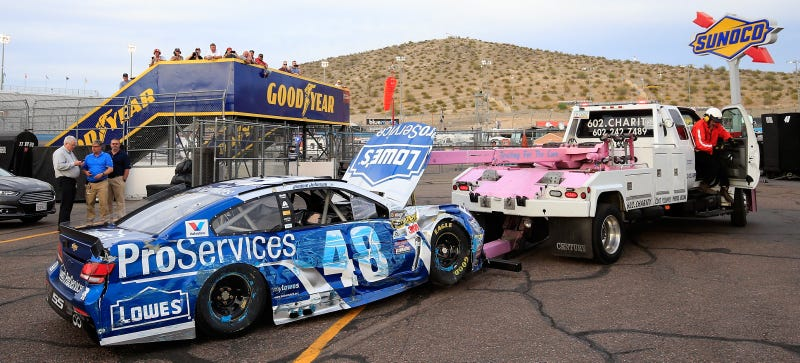 Johnson's battle-worn car comes in on a wrecker at Phoenix International Raceway. Photo credit: Getty Images