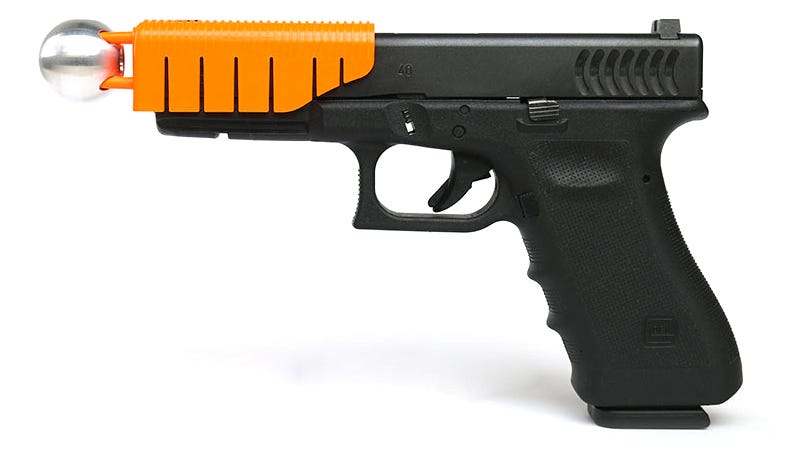 Illustration for article titled This Clip-on Handgun Attachment Makes Bullets Non-Lethal