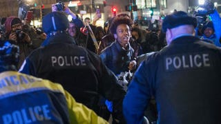 Demonstrators clash with police during a protest following the release of a video showing Chicago Police Officer Jason Van Dyke shooting and killing Laquan McDonald on Nov. 24, 2015, in Chicago.  Scott Olson/Getty Images