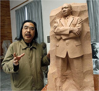 Scultor Lei Yixin with a model of the memorial (blackartinamerica.com)