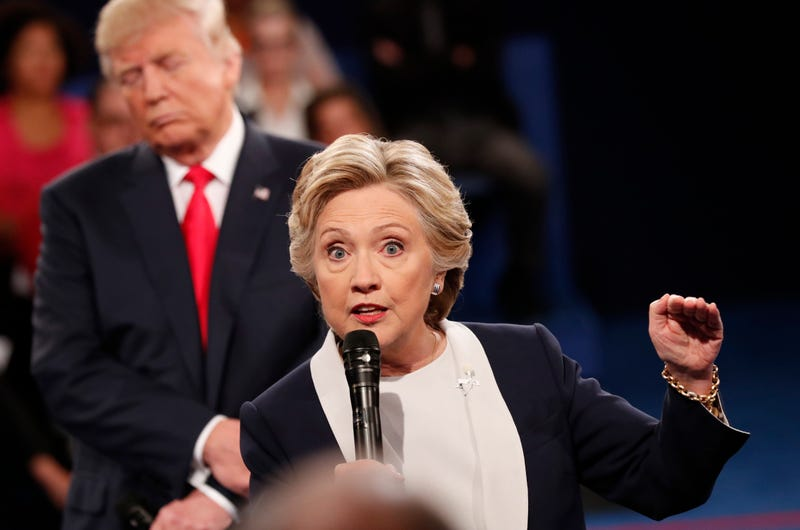 Republican presidential nominee Donald Trump and Democratic presidential nominee Hillary Clinton participate in a town hall debate at Washington University in St. Louis on Oct. 9, 2016. RICK WILKING/AFP/Getty Images
