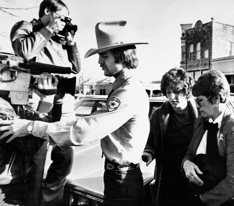 Genene Jones (right) arrives at Williamson County Courthouse in Georgetown, Texas, on Feb. 16, 1984. (Ted Powers/AP Images)