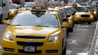 Cabs line up for fares outside the Port Authority Bus Terminal Jan. 12, 2010, in New York. DON EMMERT/AFP/Getty Images