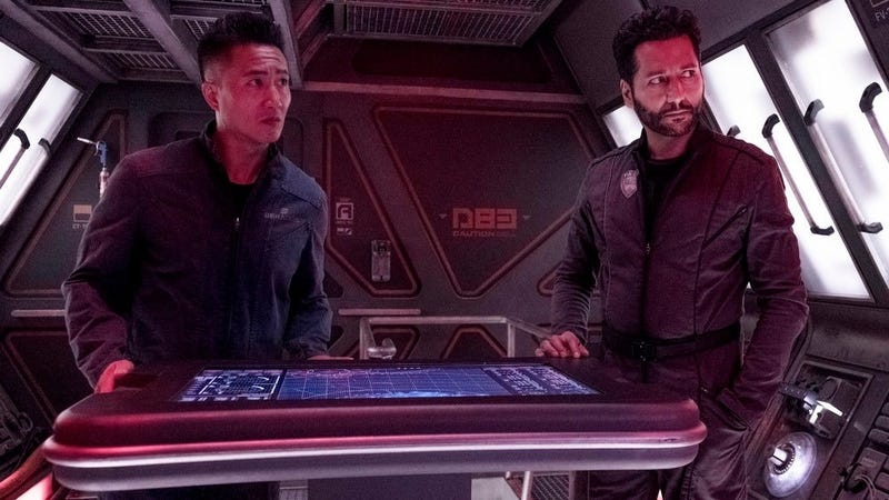 Prax (Terry Chen) and Alex (Cas Anvar) aboard the soon-to-be-renamed Rocinante.