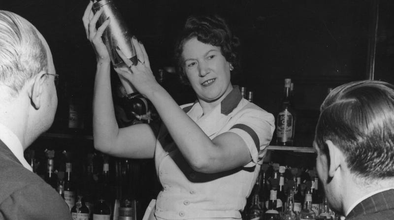 A bartender shakes cocktails at the bar of the New York Hotel, Broadway, in 1948.
