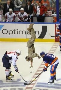Illustration for article titled Air National Guardsman Rappels From Rafters, Drops Ceremonial First Puck At Islanders Capitals Game