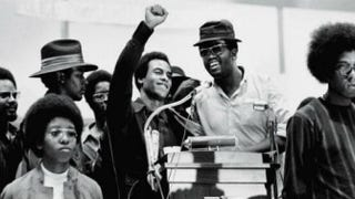 Huey Newton of the Black Panthers (with raised fist) at a Revolutionary People's Party Convention in 1970David Fenton/Archive Photos/Getty Images