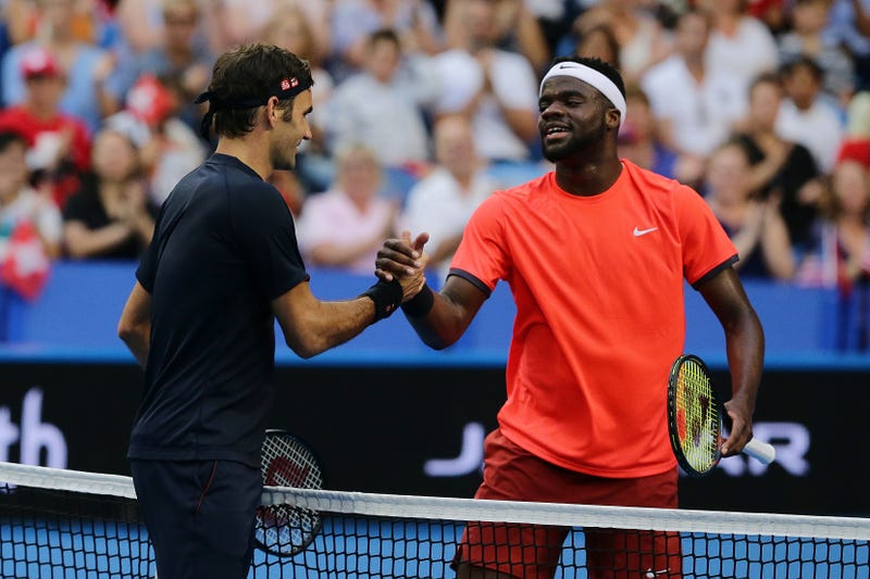 Roger Federer and 20-year-old American Francis Tiafoe