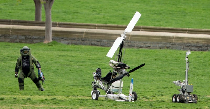 Member of the bomb squad and a bomb squad robot approach the gyrocopter (AP Photo/Andrew Harnik)