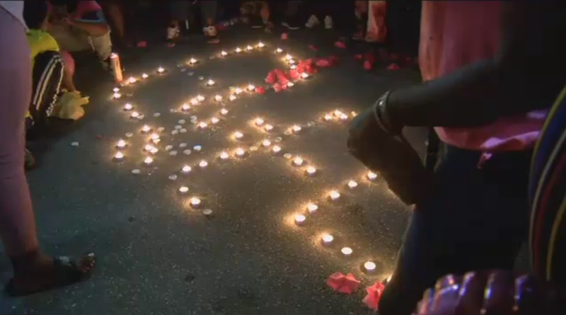 Friends and family attend a candlelight vigil in memory of Bee Love Slater.