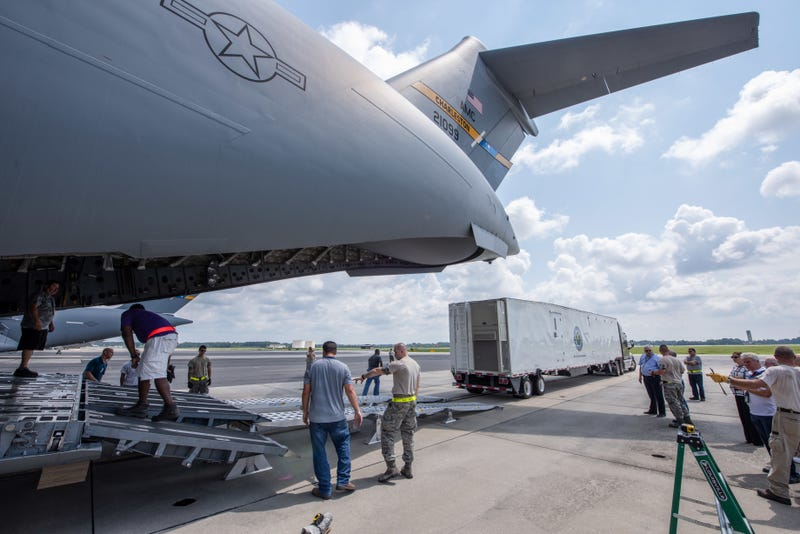 Tractor trailer being loaded on a C-17 Globemaster III.